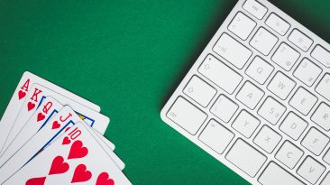 Concept of on-line poker game. Poker cards and keyboard.